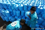 "Saudi workers load carboys of ""zamzam"" water containers at the Zamazemah United Office in Mecca, on November 7, 2010. According to Islamic belief, zamzam is a miraculously-generated source of water from God, which began thousands of years ago when Abraham's infant son Ishmael was thirsty and crying for water and discovered a well by kicking the ground. Millions of pilgrims visit the well each year while performing the Hajj or Umrah pilgrimages, in order to drink its water. (MUSTAFA OZER/AFP/Getty Images) #"