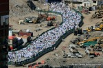 Muslim pilgrims walk past construction outside the Grand Mosque during the annual Hajj in Mecca, Saudi Arabia on Friday, Nov. 12, 2010. (AP Photo/Hassan Ammar) #