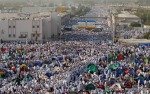 Muslim pilgrims are seen on their way towards a rocky hill called Mount Arafat, on the Plain of Arafat near Mecca, Saudi Arabia on Monday, Nov. 15, 2010. (AP Photo/Hassan Ammar) #