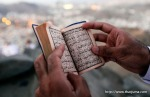 A Muslim pilgrim reads the Holy Quran at Mount Al-Noor during the annual Hajj on November 11, 2010. (REUTERS/Mohammed Salem) #