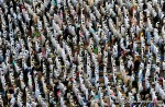 Muslim pilgrims perform Friday prayers in front of the Grand Mosque in Mecca, on November 12, 2010. (MUSTAFA OZER/AFP/Getty Images) #