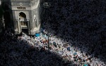 In shadows and sunlight, thousands of Muslim pilgrims pray inside the Grand Mosque in Mecca, Saudi Arabia on Friday, Nov. 12, 2010. (AP Photo/Hassan Ammar) #