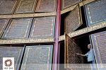 A man reads the world's largest Quran in Al-Ihsaniyah Islamic Boarding School. Palembang, Indonesia.